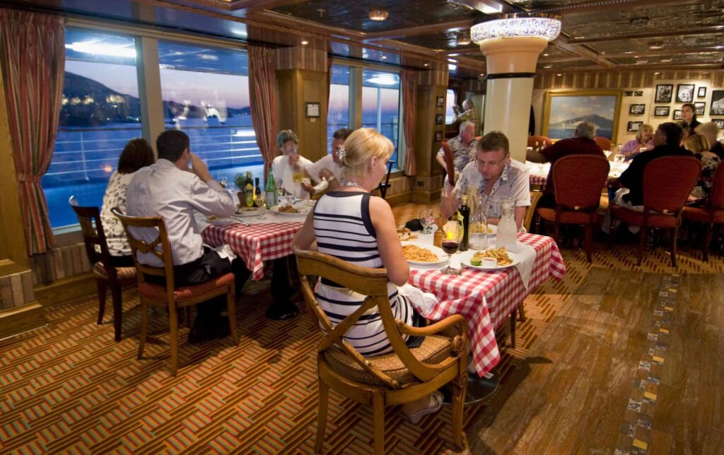 Guests aboard Carnival Magic enjoy the Cucina del Capitano restaurant that offers family-style Italian dining.
